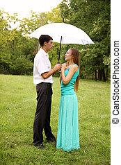 standing under a umbrella