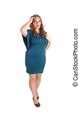 Standing woman in turquoise dress.