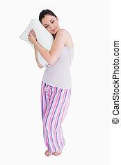 Standing woman sleeping on a pillow