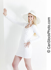 standing young woman wearing white dress and hat