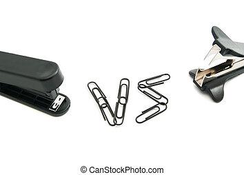 staple remover and black stapler on white