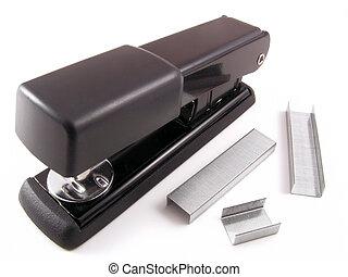 Stapler - A black stapler with staples