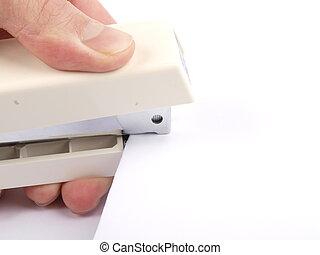 Stapler - A hand stapling paper, on white background