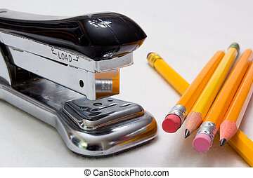 Stapler and Pencils - Stapler and pencils against a white...
