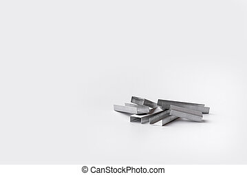 Stapler staples isolated on a white background. Close-up. Copy space. Space for text