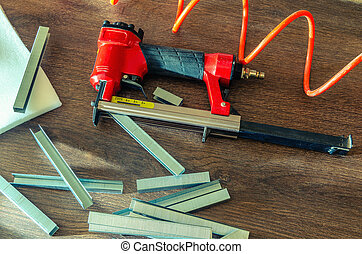 Staples, for a pneumatic stapler, in a carpentry workshop,...