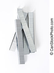 Staples in a pile.