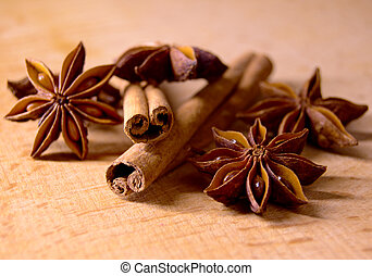 Star Anise and Cinnamon Sticks on Wooden Table