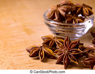 Star Anise in the Glass Bowl on Wooden Table