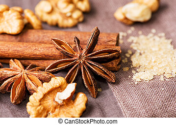 Star anise walnut brown sugar with cinnamon on cloth background