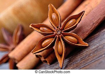 Star anise with cinnamon on table