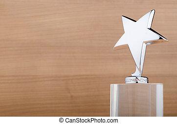 Star award against wooden background