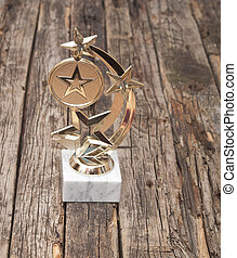 star award with space for text on old wooden table