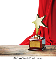 Star award wooden table and on the background of red curtain...