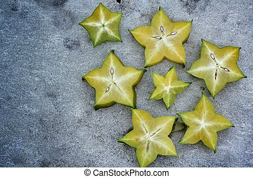 star fruit on gray background