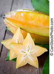 star fruit  - Star fruit on wood background .