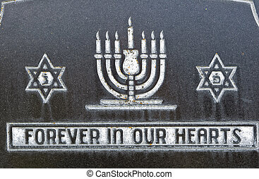 Star of David and menorah on marble tombstone. Old Jewish...