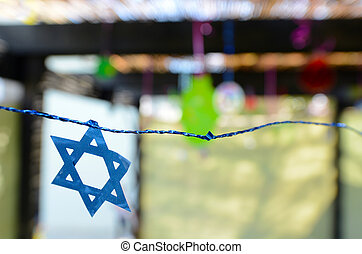 Star of David decorations inside a Jewish family Sukkah for...