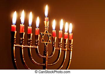 Brightly lit Hanukkah menorah on the eighth night of Hanukkah