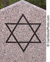 Star of David on monument in Radom, Poland.