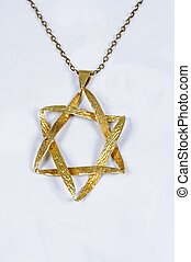 Star of David pendant. - Gold Star of David pendant against...