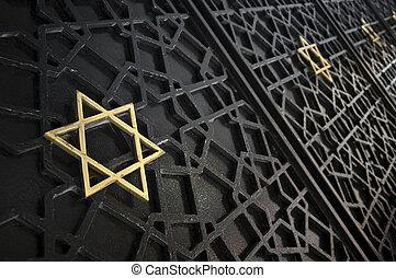 Star of David - Close up of synagogue gate entrance ornament...