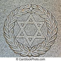 Star of David on old grunge granite tombstone. Old Jewish...