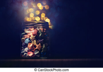 Star origami in glass jar with festival light , symbol for gift celebration in happy time