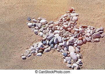 Star shape created with sea pebbles on a sand. - Star shape ...