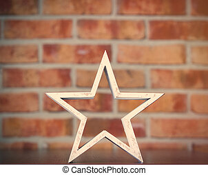 Star shape toy - Star shape on brick wall background