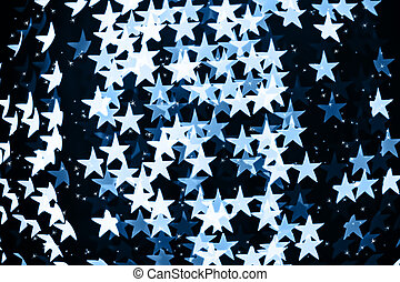 Star shaped blurred blue bokeh background with sparkles