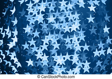 Star shaped blurred bokeh blue background with sparkles