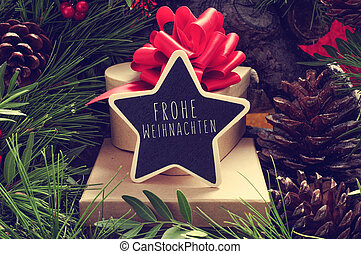 star-shaped chalkboard with the text Frohe Weihnachten, Merry Christmas in german