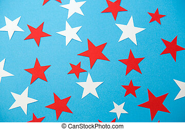 star shaped confetti decoration on blue background