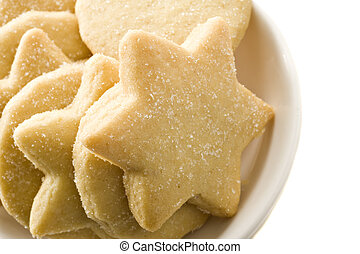Star shaped homemade cookies in a white plate