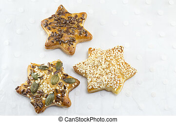 Star shaped pastry with seeds on white wooden table