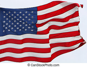 the US flag flying in the wind