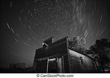 Star tracks over old abandoned garage in Saskatchewan