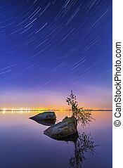 Star trail effect over the lake