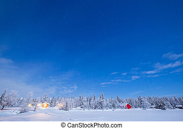 Star Trail Winter landscape with cabin hut at night in ...