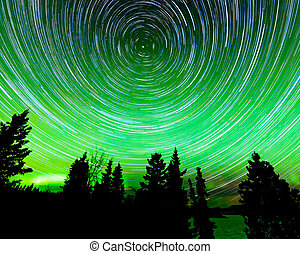 Star trails around Polaris and Northern lights -...