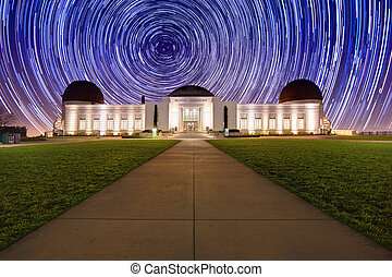 Star Trails Behind the Griffith Observatory in Los Angeles,...