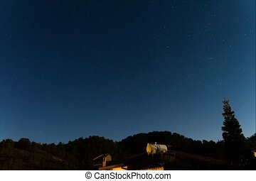 Star Trails over a house at the Troodos mountains. - Time...