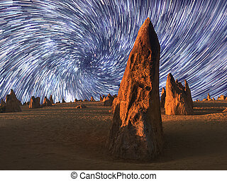 Star trails over the landscape of the Pinnacle desert ...