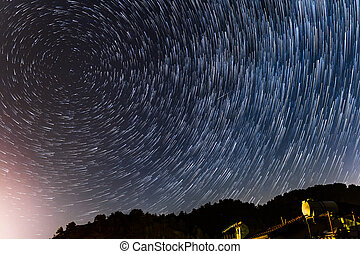 Star Trails round the polar star and over a house at the Troodos mountains