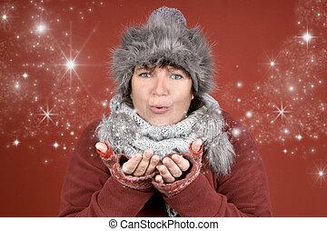 Stardust - Happy woman blowing stardust in winter season...