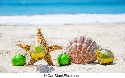 Starfish and seashell with Christmas balls - holiday concept