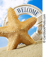 Starfish and welcome sign on beach