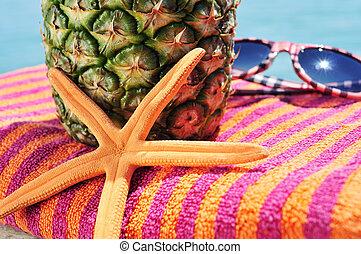 starfish, beach towel, pineapple and sunglasses