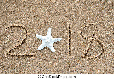 starfish in sand for New Year 2018